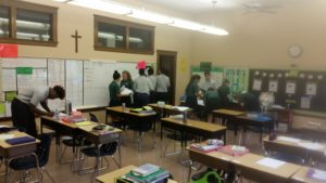 Students Exploring the Room Finding Slope in an Interactive Scavenger Hunt!
